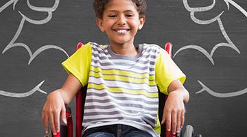 Happy boy in wheel chair
